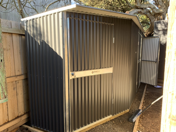 Custom corrugated garden shed in tight space