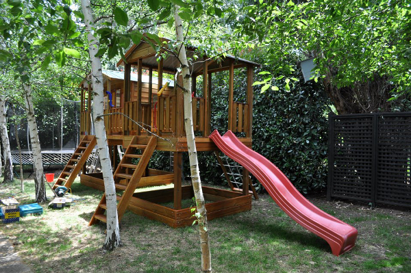 Tree house cubby with playground and slide