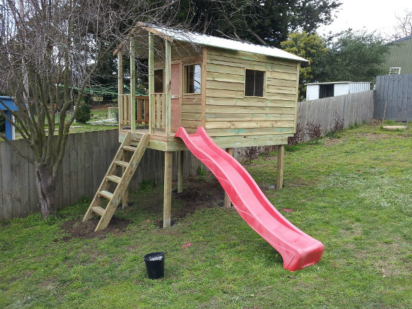 Cubby House on elevation with slide. Uneven block.
