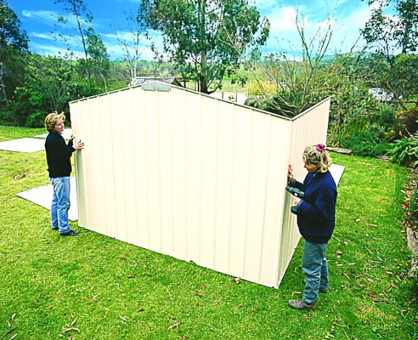 Install garden shed panels.