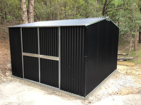 Shed with heavy duty corrugated sheeting, double doors and concrete slab.