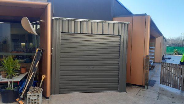 Roller Door storage shed squeezed in opening.