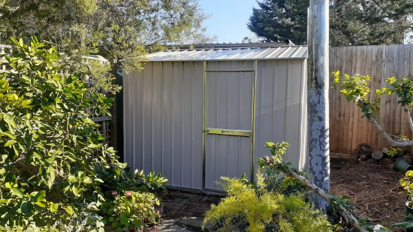 Garden Shed tucked into corner of yard.