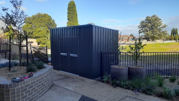 Shed with double doors and high walls.