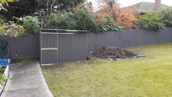 Garden Shed with sliding door with excavation.
