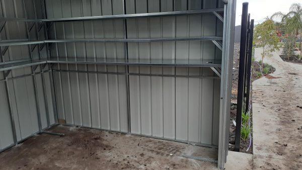 Custom shelving in roller door shed.