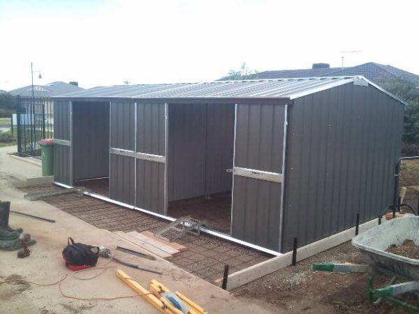 Gable Sheds side by side with double sliding doors on rebated concrete slab