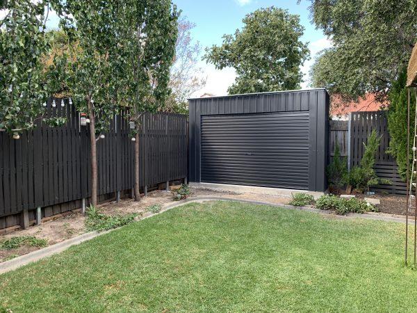 Roller Door Storage Shed In Back Garden